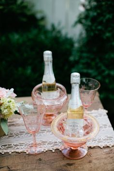 Let the bubbles flow! Love the pink champagne glasses and ice buckets.
