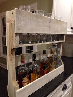 Liquor Rack I made. Holds shot glasses, whiskey glasses, and of course your liquor.