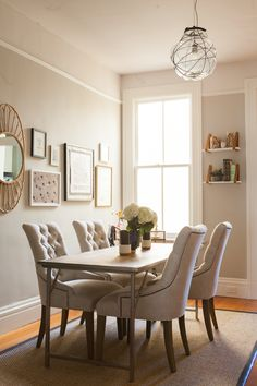 Love the contrast of this dinning area - a simple, industrial table paired with soft, feminine chairs