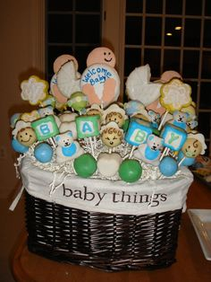 Baby Shower cake pops and cookie pops...thats what I'm taking about...gift baskets!