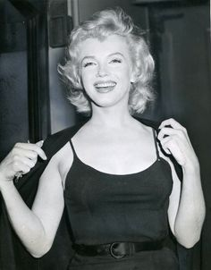 Marilyn during a press conference announcing her engagement to Arthur Miller, 1956.