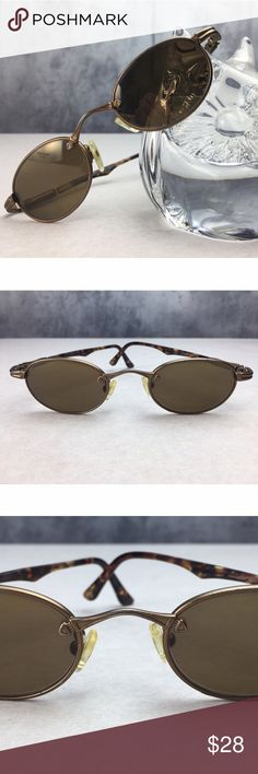 MAUI JIM VINTAGE METAL & TORTOISE OVAL GLASSES!! MAUI JIM VINTAGE METAL & TORTOISE OVAL GLASSES!! Gorgeous small oval shape frame sunglasses with great detailing!! Frame & lenses do show some wear and have that great vintage look!! Lenses look like they are also polarized, which is common among this brand! Spring arms functioning perfectly!! Maui Jim Accessories Sunglasses