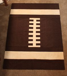 Just in time for the Superbowl! » Notions - The Connecting Threads Quilt Blog Flannel football quilt, thinking about making this the back of my Notre Dame t shirt quilt. Big one for daddy and little matching one for baby.