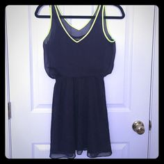 Express Navy & Neon Yellow Sheer Layered Dress Worn once, in excellent condition. Cinched waist, neon yellow piping around top. Navy under slip. Perfect for spring/summer. Can be dressed up or down with shoes/cardigans. I'm a soon-to-be mama looking to make space in her home and a little cash to provide for the new bundle of joy. No trades, please. Thanks for taking a look! Express Dresses Mini