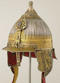 Chichak, a type of helmet (migfer) originally worn in the 15th-16th century by cavalry of the Ottoman Empire, consisting of a rounded bowl with ear flaps, a peak with a sliding nose guard passing through the peak, and an extension in the back to protect the neck. A presentation gift to the Russian court. Delegates from abroad would present their precious shields, helmets, ceremonial armor, and opulent silks and velvets in an elaborate parade before Russian dignitaries. Moscow Kremlin…