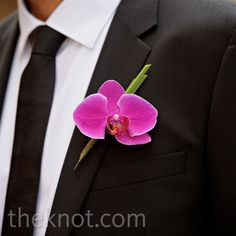 The groomsmen's hot pink phalaenopsis orchid boutonnieres coordinated with the bridesmaid bouquets.