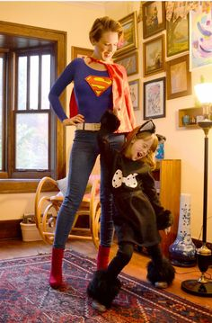 mommy and daughter on halloween! supergirl and cat girl!