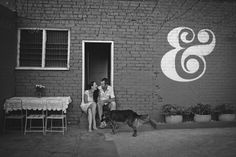 Love the ampersand painted on the wall. Photography by Samm Blake.