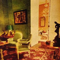 In her deluxe Paris house, a view of Sao Schlumberger's glowing green salon with its velvet walls & Savonnerie carpet. Through the doors can be seen the even more formal 'salon jaune.' Horst, 1974.