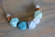 Silicone chew necklace, nursing necklace, chew beads, teething necklace, wood teething necklace, baby shower gift, mommy necklace, new mom by FlyLilBird on Etsy https://www.etsy.com/ca/listing/272731502/silicone-chew-necklace-nursing-necklace