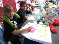 Art showcase with t-shirt, plushie, marker art, sculpey, metalwork and more!  Creative Arts Inc. summer art camp.