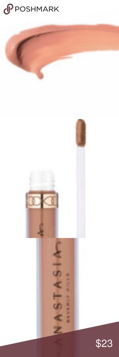 """NIB ANASTASIA Beverly Hills NAKED LIQUID LIPSTICK No Trades. Guaranteed Authentic BNIB ANASTASIA Beverly Hills LIQUID LIPSTICK in """"NAKED"""" - a LIGHT PEACHY NUDE. ANASTASIA created this intensely pigmented, cult-favorite liquid formula that delivers a rich, long-wearing matte look to lips. Use the flat sponge-tip applicator to apply Anastasia Beverly Hills Liquid Lipstick with precision for an unforgettable look that lasts for hours. Gorgeous color without overdoing it. 3.2 g/0/11 oz Anastasia…"""