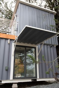 House Beautiful Marketplace this is a two-story shipping container tiny house for sale that's