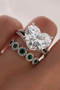 Diamond Engagement ring paired with an Emerald Eternity ring Emerald Eternity Ring, Diamond Jewelry, Jewelry Rings, Beautiful Diamond Rings, Bespoke Jewellery, Diamond Engagement Rings, Diamonds, Hearts, Anniversary