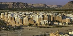 """Manhattan,Yemen - in the Hadramaut Valley,East of Yemen, the famous city of Shibam, Unesco World Heritage site. The city is famous for its mudbrick-made buildings.500 of them are tower houses. The city is called """"the oldest skyscraper city in the world"""" or """"the Manhattan of the desert"""". Here are some of the tallest mud buildings in the world.To protect them from rain and erosions fresh layers of mud must be applied regularly on the walls . For that shooting I climbed on the cliff to have a…"""