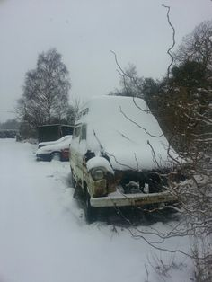 Snowy old wreck of a Ford Transit.
