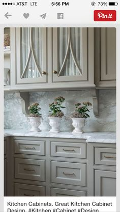 Can't wait to paint my kitchen cabinets this color fieldstone by Benjamin Moore. Going to also do the countertops/back splash in white marble as pictured.