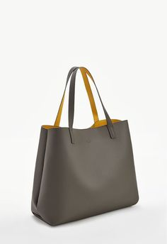 Nothing like a classic to get you through those long days. The Ace (similar to our Montage) a structured tote that features top handles and a removable pouch to store your everyday essentials. Reversible....