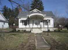 830 Chestnut Avenue, Sidney, OH 45365 Chestnut Avenue, Ohio Real Estate, Arch Doorway, Concrete Steps, Side Porch, Roof Lines, Plaster Walls, Craftsman Bungalows, Old House Dreams