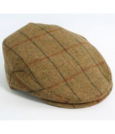 96bf3eaff97 Traditional peak style cap with a button fastening. Made from 100% woollen  fabric woven