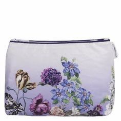 Designers Guild Alexandria Lila Medium Washbag: A chic digitally printed oil-cloth washbag carrying Designers Guild's refined hand-painted Alexandria botanical design. Poppies and anemone feature on a shading backdrop.