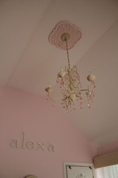 Ceiling Medallion in Mediterranean Vine design by Marie Ricci.  Shown in distressed pink.