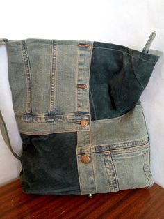 Check out this item in my Etsy shop https://www.etsy.com/listing/608523499/a-bag-made-of-jeans-and-leather-the