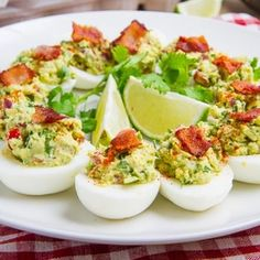 Bacon Guacamole Deviled Eggs-follow pin to website or use this variation: 2 T mashed avocado, 1 t minced fresh cilantro, 1/2 t grated lime peel, 1/2 t lime juice, garnish: cherry tomatoes