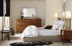Room & Board bedroom inspiration - creamy taupe walls, walnut dresser, upholstered bed frame