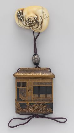 Inrô with design of thatched hut, 18th–19th century  Japanese  Lacquer; ojime: pewter; netsuke: ivory