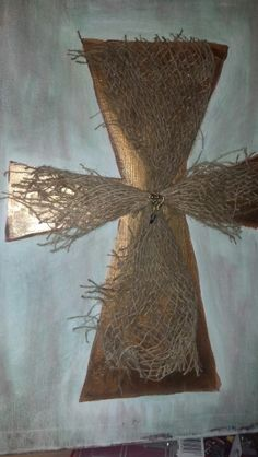 Painted cross on canvas with burlap.