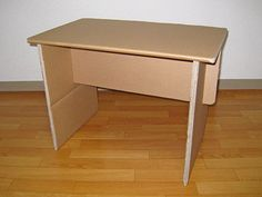 Picture of Simple knock-down cardboard end table (flat pack) Would be really cute spray painted.