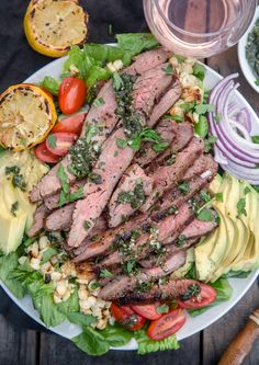 This Grilled Flank Steak was marinaded in a savory soy and rosemary mix, and then tossed with greens and veggies for an incredible full flavored and hearty salad! Perfect for summer, and even better with a glass of rosé. #winepairing #flanksteak #grilledsteak #steaksalad #steakmarinade #vindulge