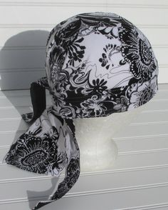 Black and white floral skull cap, doo rag, chemo hat, cancer hat, scrub hat with a built in sweat band. Handmade.