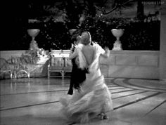 "Fred Astaire and Ginger Rogers in Top Hat (1935). This moment in ""Dancing Cheek to Cheek"" is Fred and Ginger at their most exquisite. Really. After all these years, this number still makes me gasp. And that dress!  -via pickurselfup"