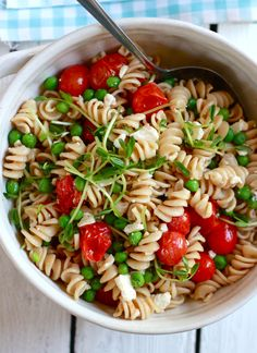 Whole wheat pasta salad with feta and pea shoots. It& great for entertaining or a light lunch. Tomato Pasta Salad, Cherry Tomato Pasta, Pasta Salad Recipes, Cherry Tomatoes, Feta, Whole Wheat Pasta, Fusilli, Penne, Pasta Dishes