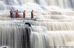 Monks at Pongua falls, Vietnam by Dang Ngo