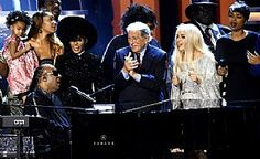"""Stevie Wonder is joined by Tony Bennett and Lady Gaga during the finale of """"Stevie Wonder: Songs in the Key of Life – An All-Star Grammy Salute"""" at Nokia Theatre L.A. Live Feb. 10. (Chris Pizzello/Invision/AP)"""