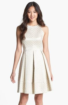 Free shipping and returns on Eliza J Jacquard Fit & Flare Dress (Regular & Petite) at Nordstrom.com. Embossed jacquard rings add gleaming metallic luster to a clean-cut sleeveless dress finished with a deeply pleated skirt with plenty of fun flounce.