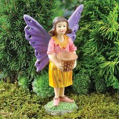 Gardening Fairy with a Basket. www.teeliesfairygarden.com . . . Bring home this gardening fairy with a basket today! She'll take care of your garden and plant beautiful flowers and plants and make your garden livelier! #fairyspring