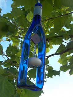 This recycled wine bottle wind chime would be wonderful in my garden. Sold on Etsy (http://www.etsy.com/shop/GroovyGreenGlass?section_id=7945465 ), the wind chimes are made from blue, green, brown and yellow reclaimed wine bottles.