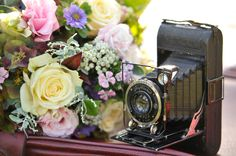center pieces - flowers & old cameras