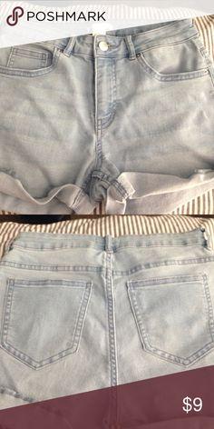 Used H&M Light Denim Cuffed Mid Waist Jean Shorts Light blue denim size 4. Mid rise. Typical 5 pocket jean Shorts. Cuffed legs. Gently used in good condition. K may H&M Shorts Jean Shorts