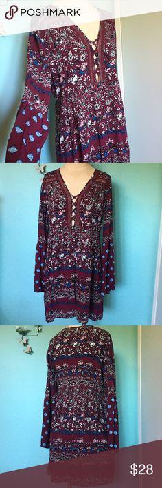 Tilly's Boho Floral Swing dress Socialite Adorable deep merlot bohemian mixed print dress from Tillys by the brand Socialite.  Flowy bell sleeves and lace trim make this dress sexy too! Perfect with leggings and boots! Only worn twice. Adorable with sandals too! Tilly's Dresses
