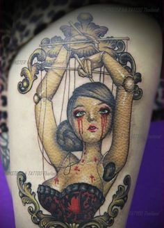 This tragic beauty was designed by Pang. InkedMagazine tragic beauty Puppet tattoo tattoos Inked Ink art