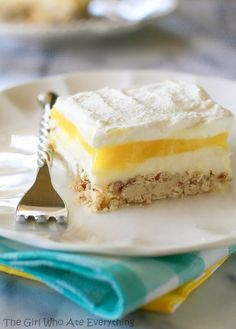 Lemon Lush - buttery pecan crust with a lemon cheesecake filling, lemon pudding layer, and whipped cream.