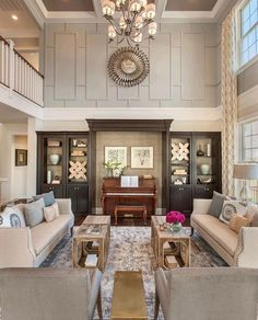 Toll Brothers; nice way to rein  in the crazy proportions of this room... very handsome!