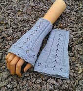 These adorable fingerless mittens sport both cables and eyelet-pattern!