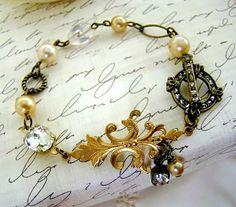 Paris Chic Fleur de lis Pearl & Rhinestone Charm Bracelet by Alyssabeths http://www.etsy.com/listing/87469048/paris-chic-fleur-de-lis-pearl-rhinestone