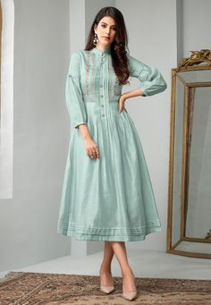 Make the heads flip whenever you dress up in this stunning Baby Blue Color Cotton Slub Readymade Long Kurtis Patterns. the thread work seems to be chic and Designer Kurtis, Designer Wear, Designer Dresses, Silk Kurti Designs, Kurta Designs Women, Blouse Designs, Indian Kurtis Designs, Cotton Frocks, Cotton Dresses